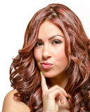 Gorgeous latina with long wavy red tinted hair. And brown eyes in lime green dress Royalty Free Stock Photography