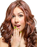 Gorgeous latina with long wavy red tinted hair. And brown eyes in lime green dress Royalty Free Stock Images