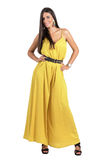 Gorgeous Latino fashion model in ocher jumpsuit posing to camera Royalty Free Stock Images