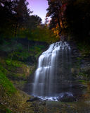 Gorgeous Light over Majestic Waterfall Royalty Free Stock Photos