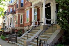 Gorgeous line of row houses on quiet city street Stock Image