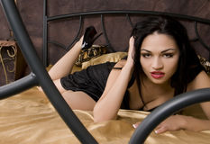 Gorgeous Lingerie Model on Bed. Stock Photography