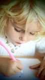 Gorgeous little girl drawing Royalty Free Stock Photography