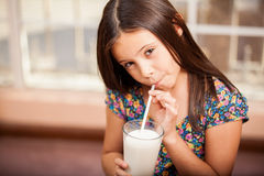 Gorgeous little girl drinking milk Royalty Free Stock Photography