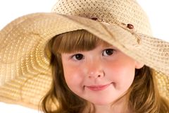 Gorgeous little lady. Portrait of gorgeous little girl with brown eyes wearing straw hat isolated on white Royalty Free Stock Images