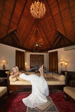 Gorgeous, lovely bride, model lying on sofa in beautiful villa. Royalty Free Stock Image
