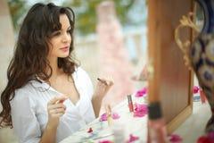 Gorgeous, lovely bride, model preparing to wedding day using lip Stock Photo