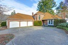 Gorgeous luxury brick home exterior. With three garage spaces. Northwest, USA Royalty Free Stock Photos