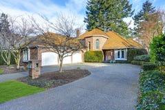 Gorgeous luxury brick home exterior. With three garage spaces. Northwest, USA Royalty Free Stock Photo
