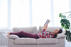 Gorgeous madam having rest while reading book Royalty Free Stock Photos