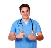 Gorgeous male nurse with ok gesture Stock Photos