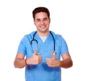 Gorgeous male nurse with ok gesture Stock Photos