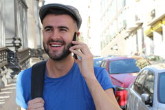 Gorgeous man calling by phone outdoors with copy space Stock Images