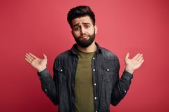 Gorgeous man with sceptic expression royalty free stock images