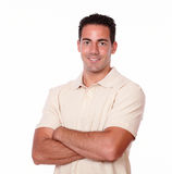 Gorgeous man smiling and crossing his arms Stock Photos