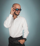 Gorgeous man in sunglasses and white shirt smiling Royalty Free Stock Image
