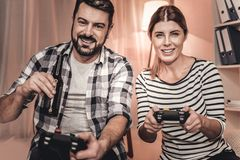 Gorgeous man and woman playing a video game Stock Photos