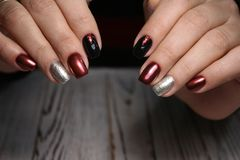 Gorgeous manicure, dark purple tender color nail polish, closeup photo royalty free stock photos
