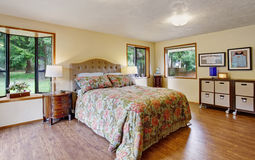 Gorgeous master bedroom with sliding lgass door and hardwood flo Stock Image