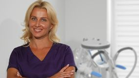 Gorgeous mature female doctor posing at her office stock photography