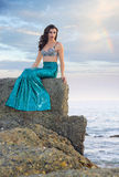 Gorgeous mermaid. An attractive girl dressed as mermaid by the sea Stock Images