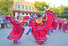 Gorgeous Mexican women dancing. Mexican women dancing at Varna square,Bulgaria during Parade of 23rd International Folklore Festival participants.August 3rd 2014 Stock Image