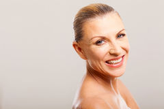 Mid age woman. Gorgeous mid age woman smiling against white background royalty free stock photo