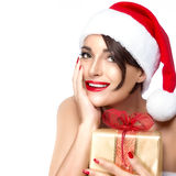 Gorgeous Miss Santa with a Golden Gift Royalty Free Stock Images