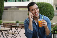 Gorgeous mixed race male using phone.  Stock Image