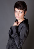 Gorgeous Model in Black Satin Shirt Stock Images