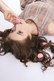 Gorgeous model eating sweets. diet concept Royalty Free Stock Photo