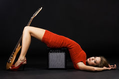 Gorgeous model with electric guitar and amplifier Royalty Free Stock Photos