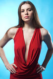 Gorgeous model in elegant red gown Royalty Free Stock Photos
