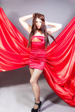 Gorgeous model in red satin Stock Photo