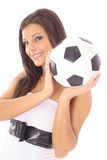 Gorgeous model with a soccer ball Royalty Free Stock Photography