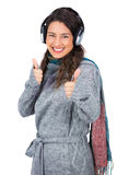 Gorgeous model with winter clothes thumbs up Stock Photos