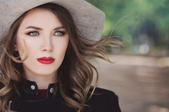 Gorgeous Model Woman in a Hat Outdoors Stock Photo