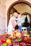 Grandmother and little boy having fun on Thanksgiving on a blurred background. Family holidays concept. Gorgeous modern grandmother having fun with a funny stock photos