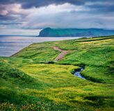Gorgeous morning view of Vagar island, Gasadalur village location. Dramatic summer scene of Faroe Islands, Denmark, Europe. Sunset