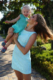 Gorgeous mother having fun with her cute little daughter Royalty Free Stock Image