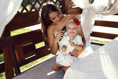 Gorgeous mother having fun with her cute little daughter Royalty Free Stock Photos