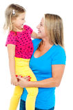 Gorgeous mother holding her daughter Royalty Free Stock Image