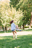 Gorgeous mother playing with her handsome son in the park Royalty Free Stock Photography