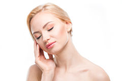 Gorgeous naked blonde woman with closed eyes posing on white, body care concept Stock Photos