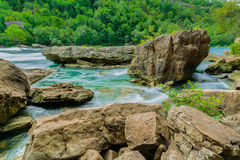 Gorgeous natural landscape view of Niagara Falls river with big rock and stones Royalty Free Stock Image