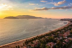 Seascape with Aerial View of Nha Trang Beach, Islands, Mountains and Bay at Colorful Sunrise stock photo