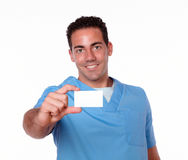 Gorgeous nurse man holding a blank card Royalty Free Stock Photo