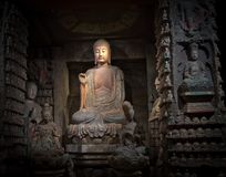 Gorgeous and old Budha in China. The view is great ; the sun illuminate the face of the statue Royalty Free Stock Photography