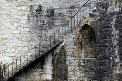 Gorgeous old metal staircase on weathered stone Royalty Free Stock Images