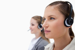 Gorgeous operators using headsets Stock Photo